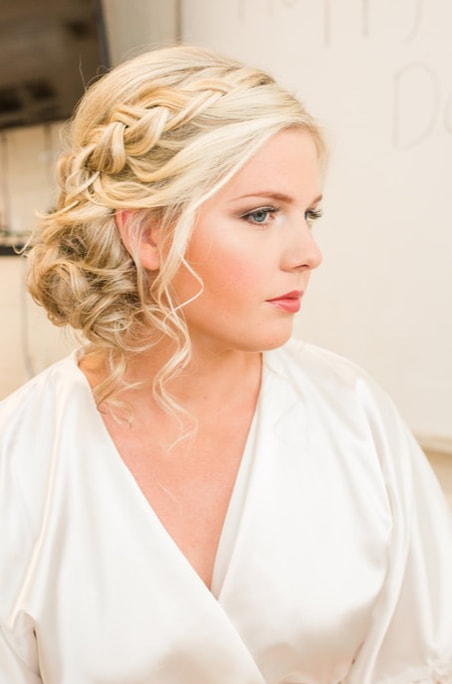 Gorgeous bride displaying her updo comprised of her dark brown hair.